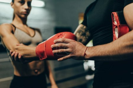 trainer and female boxer