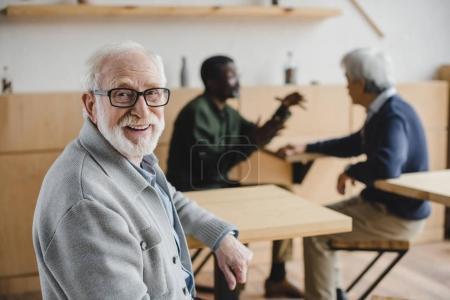 senior man sitting in cafe