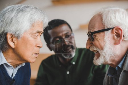 senior friends playing staring contest