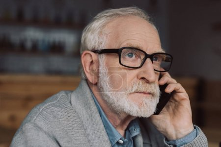 senior man talking by phone