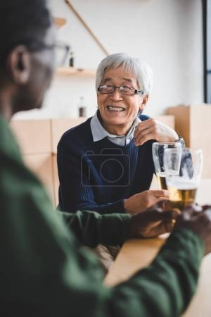 senior friends drinking beer