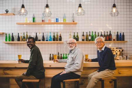 Photo for Group of multiethnic senior friends drinking beer together - Royalty Free Image