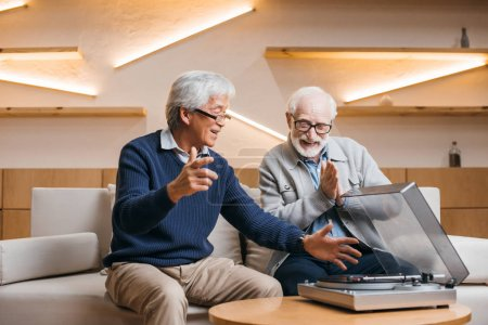 senior friends listening vinyl record