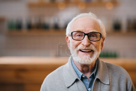 Photo for Close-up portrait of happy senior man looking at camera - Royalty Free Image