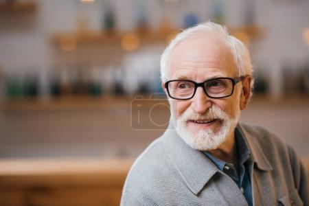 Photo for Close-up portrait of happy senior man looking away - Royalty Free Image