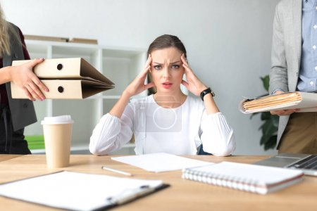 Photo for Cropped image of tired woman with headache having a lot of work - Royalty Free Image