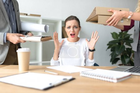 Photo for Cropped image of woman shouting because of a lot of work - Royalty Free Image