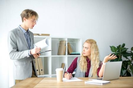 Woman talking with colleague
