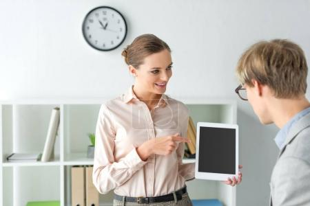 woman pointing on something on tablet