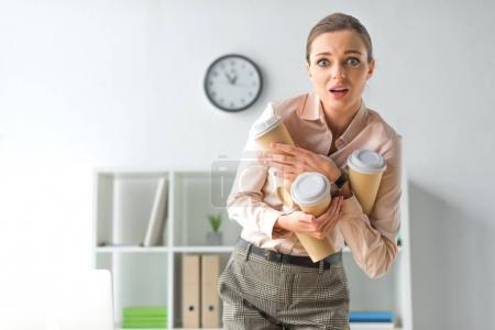 frightened woman with coffee cups