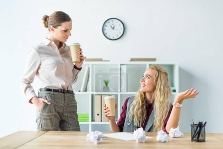 female colleagues drinking coffee