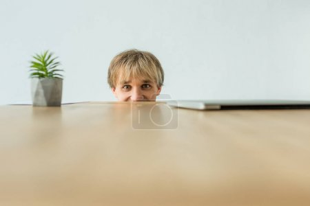 Man looking out from table