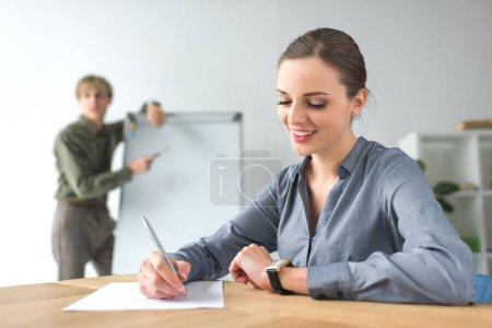 businesswoman writing down something
