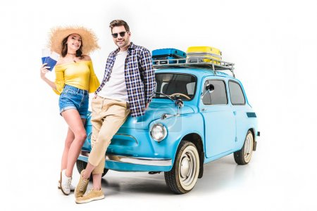 tourists standing by car