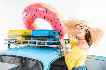 woman putting inflatable donut on car