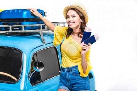 woman with tickets next to vintage car