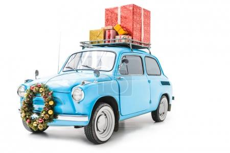 Photo for Blue old car with christmas wreath and gifts on roof isolated on white - Royalty Free Image