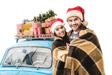 couple in plaid with car and christmas gifts