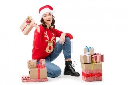 woman sitting on floor with christmas gifts