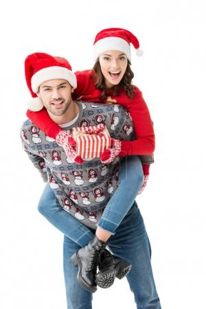 young couple in santa hats