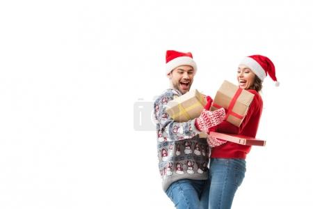 Photo for Happy young couple holding stacks of christmas gifts isolated on white - Royalty Free Image
