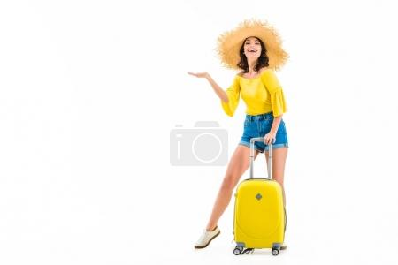 woman with luggage showing something with hand