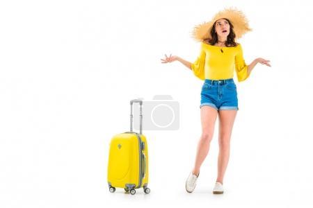 woman with luggage shredding shoulders