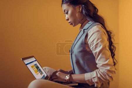 businesswoman using laptop with booking website