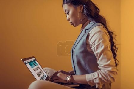 businesswoman using laptop with amazon website