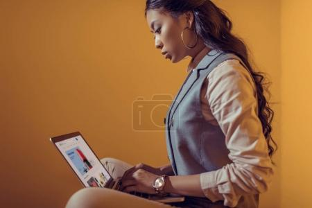 businesswoman using laptop with ebay website