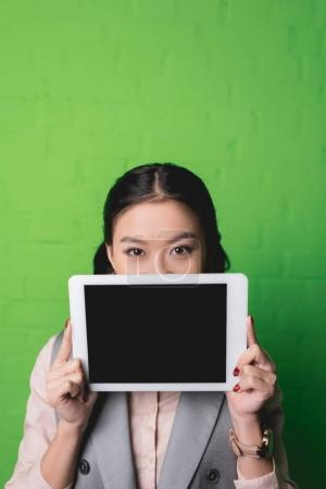 Photo for Asian woman presenting digital tablet with blank screen - Royalty Free Image