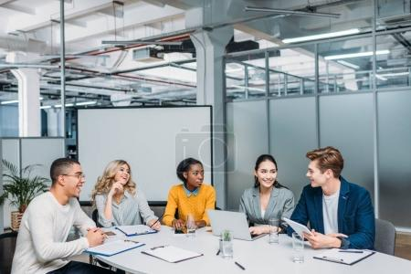Photo for Multiethnic group of business partners having conversation at modern office - Royalty Free Image
