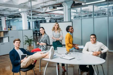 group of young business partners in conference room at modern loft office