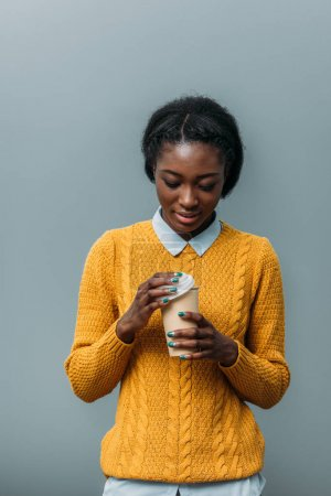 Photo for Young african american woman with disposable cup of coffee - Royalty Free Image