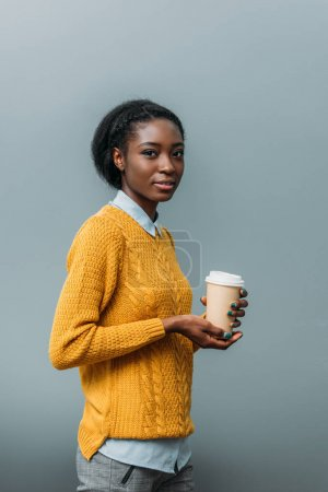 beautiful african american woman with disposable cup of coffee
