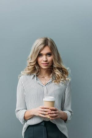 young beautiful woman with disposable cup of coffee