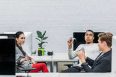 business partners with paper planes relaxing at modern office