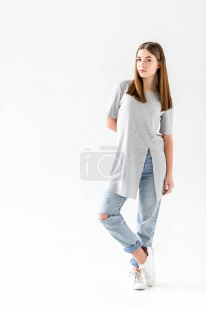 pensive young woman in stylish clothing looking at camera,  isolated on white