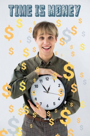 Smiling businessman holding wall clock in hands on white with dollar signs flying around