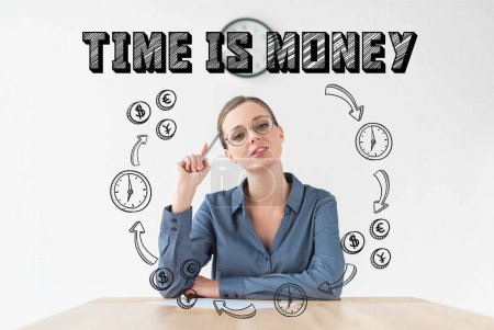 thoughtful businesswoman sitting at table and holding pencil in hand, with time is money inscription and hand drawn business circuit