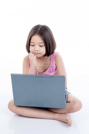 Asian child girl using laptop and thinking