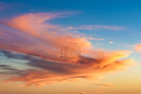 Photo for Spectacular sunset with soft clouds in the desert sky - Royalty Free Image