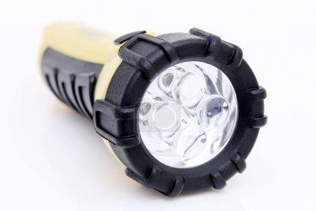 Photo pour Lampe de poche LED électrique sur fond blanc - image libre de droit