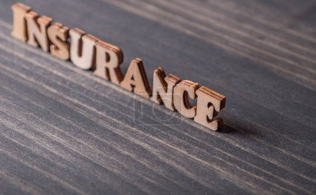 INSURANCE text on wooden background