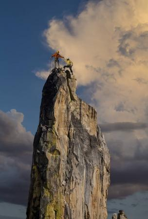 Photo for Team of climbers conquer the summit. - Royalty Free Image
