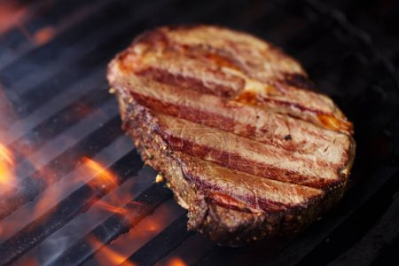 Photo for Beef steak on barbecue grill with flame - Royalty Free Image