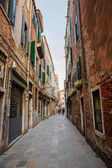 Italy, Venice, February 25, 2017. Street in Venice among old hou