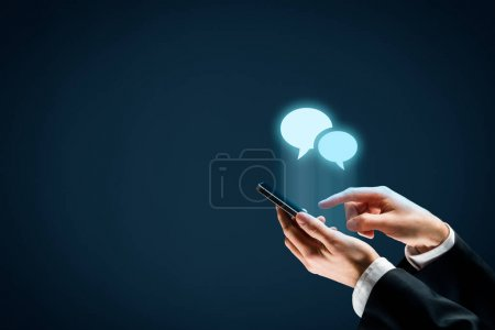 Photo for Communicate (chat) on smartphone concept. Mobile phone user and speech bubbles icons. - Royalty Free Image