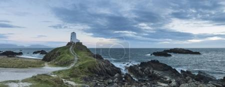 Stunning Summer panoramic landscape image of lighthouse on end o