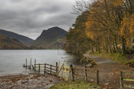 Photo for Beautiful Autumn Fall landscape image of Buttermere during moody Autumn Fall morning - Royalty Free Image